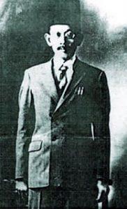 Sheikh Tahir Jalaludin berkot, kemeja dan tie. Imej dari bicaraassyira.